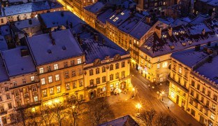 The Lviv-based architectural historian and I were sitting in this Ukrainian city at a cafe grafted onto a pink neo-Renaissance building with elaborate white trim and statues of nudes. Most of this architectural confection, which dates from 1901, is still occupied by the George Hotel, where luminaries like Jean-Paul Sartre and Maurice Ravel once stayed...